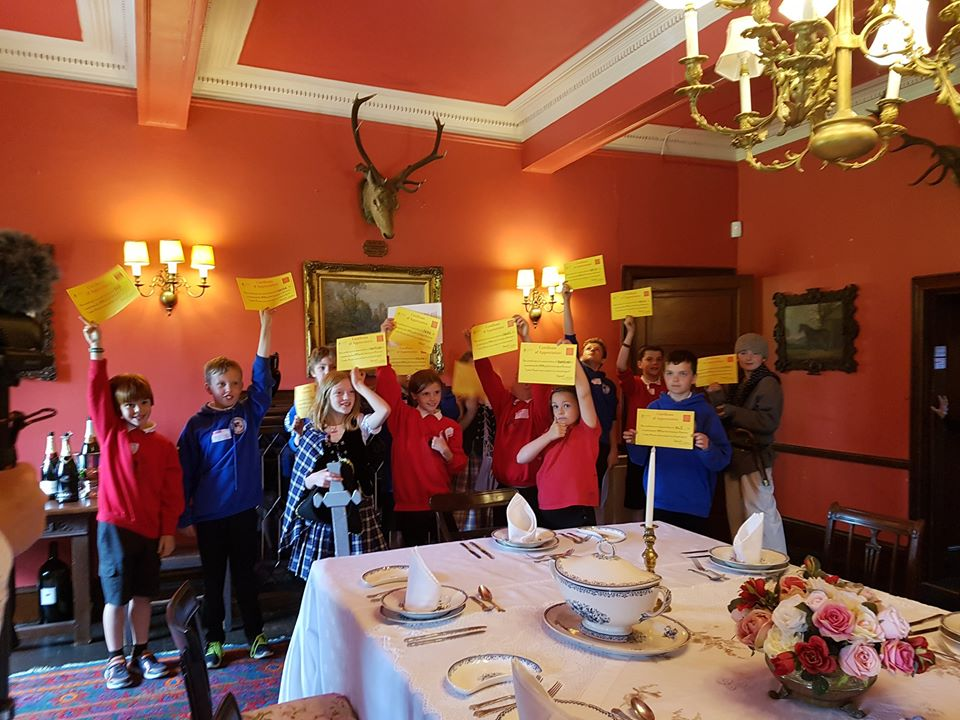 Braemar primary school children holding certificates after being guides for the day